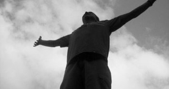 Man-with-open-arms-looking-up-to-the-sky_black