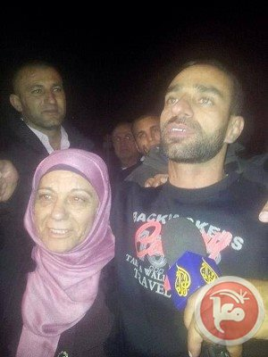 Samer Issawi, with his mother, when he was released from prison and returned home to Jerusalem, December 2013.