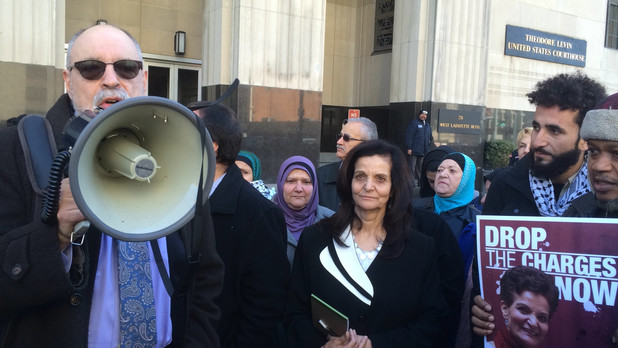 Rasmea Odeh listens to her lead attorney Michael Deutsch following her sentencing, outside the US Courthouse in Detroit.