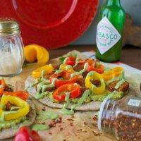 Chipotle Sausage, Peppers, & Guacamole Flatbreads with Cilantro Cream