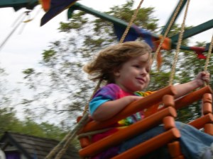 girl in swing MorgueFile
