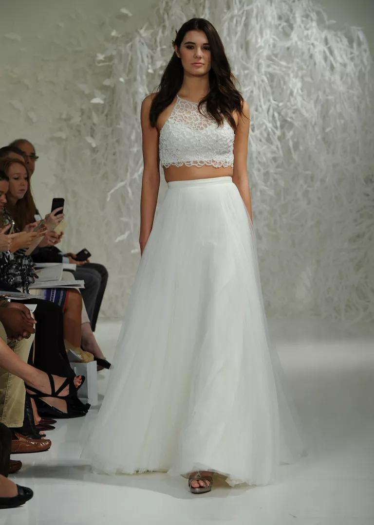 watters wedding dresses bridal fashion week fall crop top wedding dress Watters Fall crop top and skirt wedding dress with illusion neckline lace top and layered