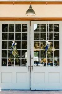 Hanging Greens With Navy Ribbon Door Decor