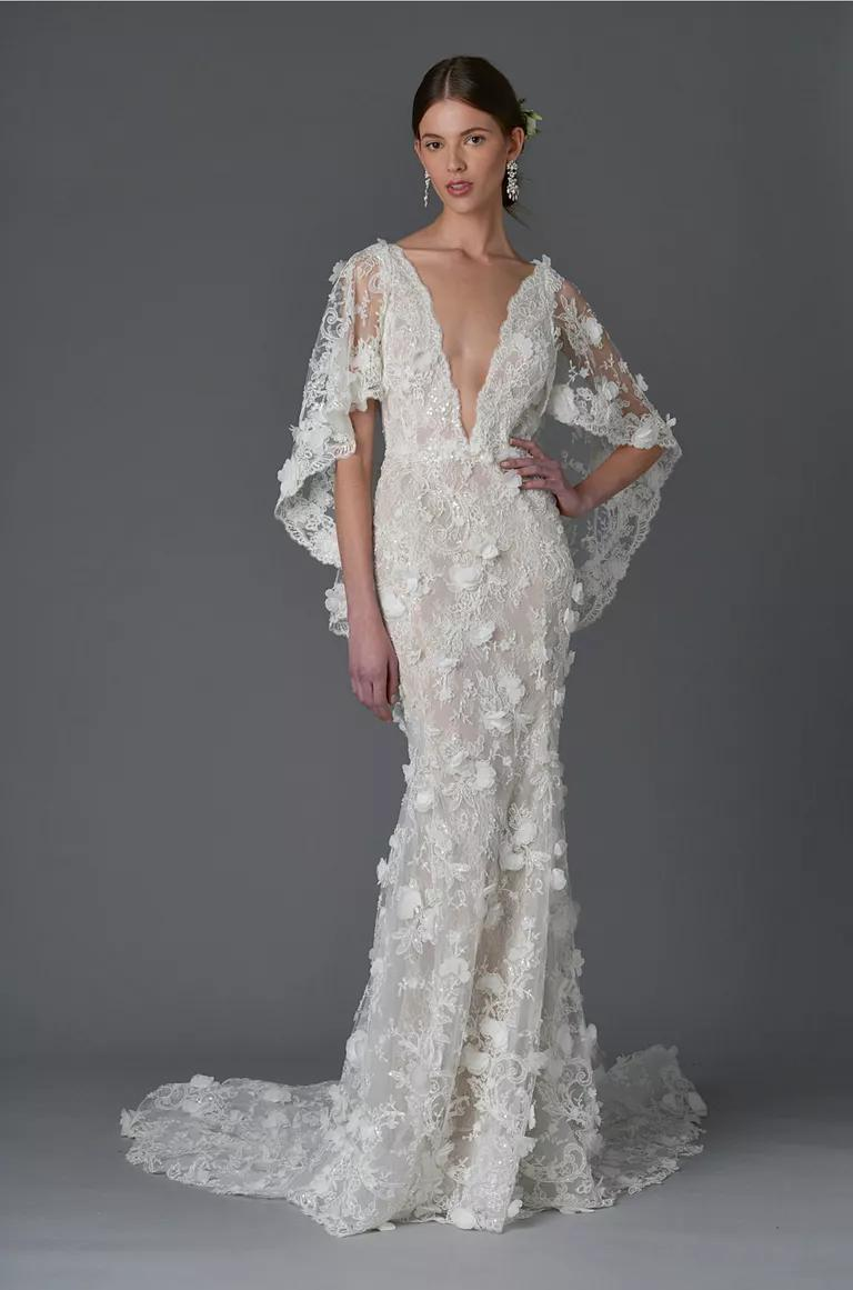 marchesa wedding dresses bridal fashion week spring wedding dress cape Marchesa Spring sheath wedding dress with plunging neckline and floral and lace embroidered cape