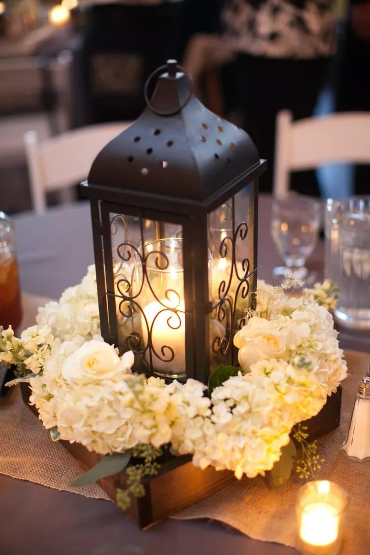 black lantern and white hydrangea centerpiece photo lanterns for weddings