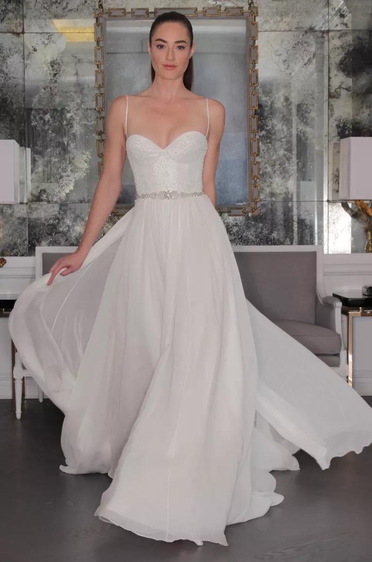 romona keveza wedding dresses bridal fashion week wedding dress corset top Romona Keveza wedding dress with lace detailed corset bodice and spaghetti straps beaded belt