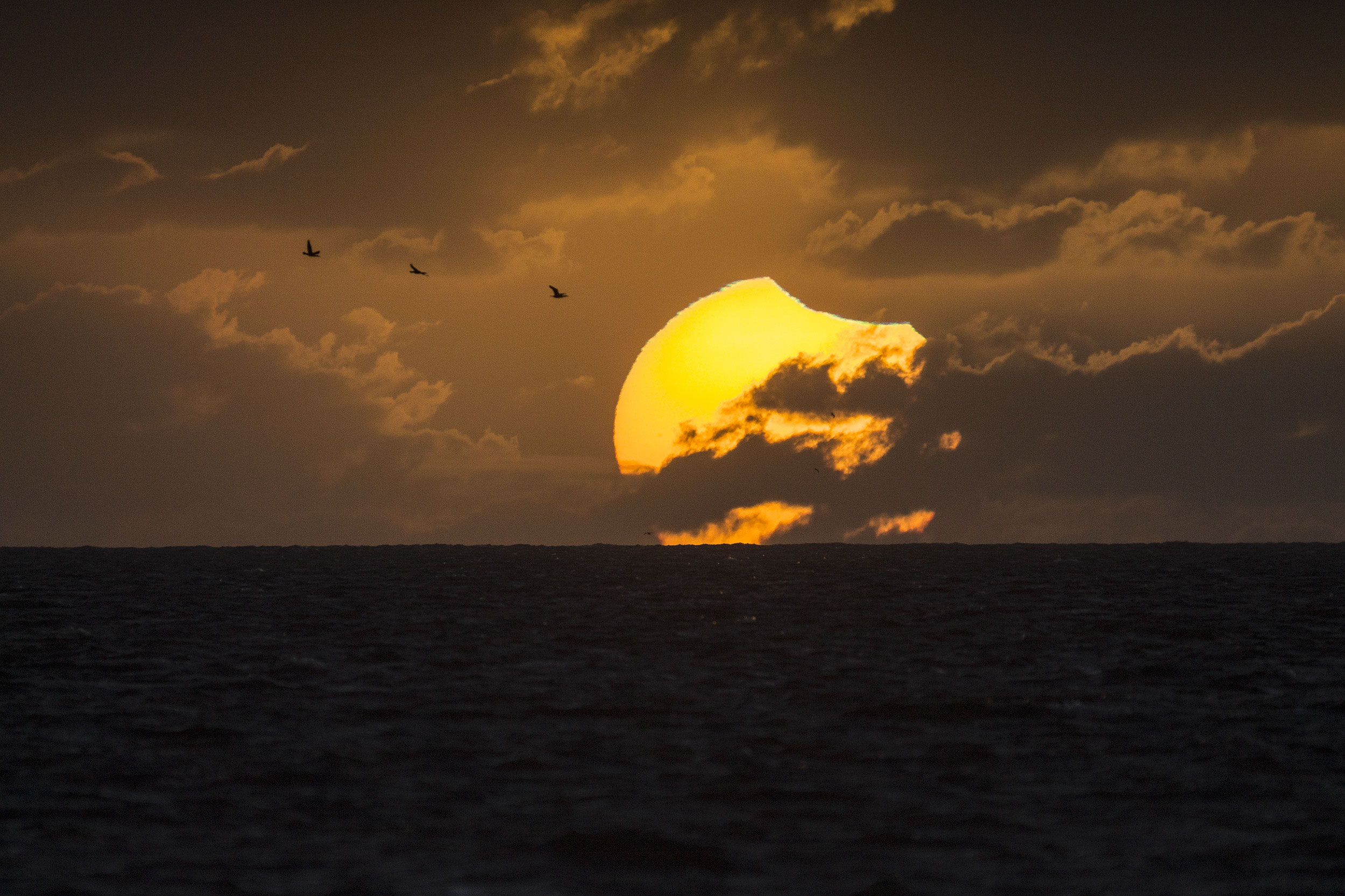 Apod 2014 April 30 A Partially Eclipsed Setting Sun