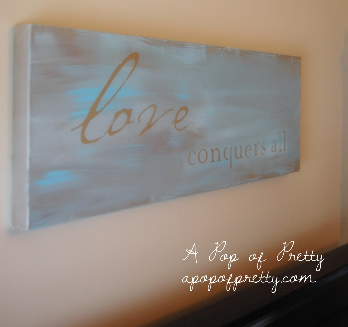 "DIY Wall Art: ""Love Conquers All"" Painted Canvas"