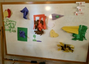 Construction paper, torn and folded to represent where each of us was emotionally, spiritually, or otherwise at the beginning of the dialogue. Mine is the stringy green one to the far left.