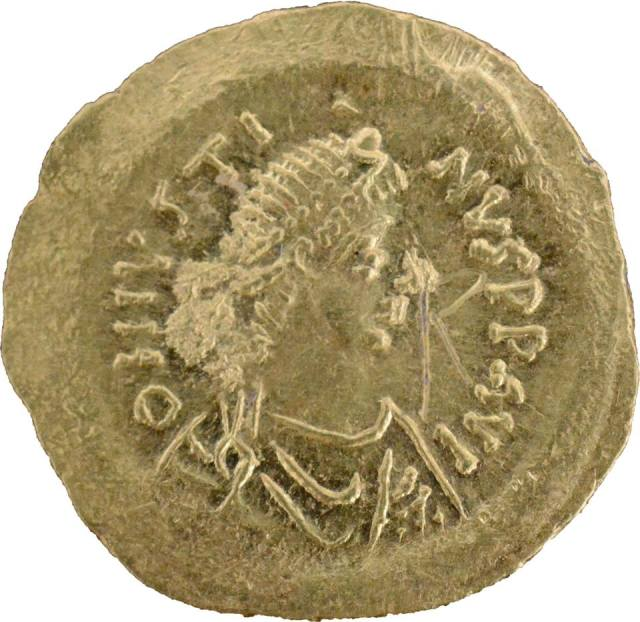 This newly found gold coin of Byzantine Emperor Justine I (r. 518-527 AD) was minted to pay for the construction of the Early Byzantine Fortress in Agathopolis but was never in use, according to the archaeologists. Photo: Tsarevo Municipality