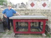 This stunningly re-engineered Victorian cast-iron, originally steam-powered saw bench with its huge, heavy 6 feet x 3 feet x 3 inch thick (1830mm x 915mm x 75mm)  flag stone top – salvaged from an historic Lancashire Cotton Mill, would make a truly fantastic, eye-catching and very useful Quirky Industrial Garden Table, ideal for 'al fresco' dining, barbeques or wine and ale parties.  Indeed, this Quirky Table would look fantastic if set up in a garden or, within the grounds of a country pub, a hotel or restaurant.