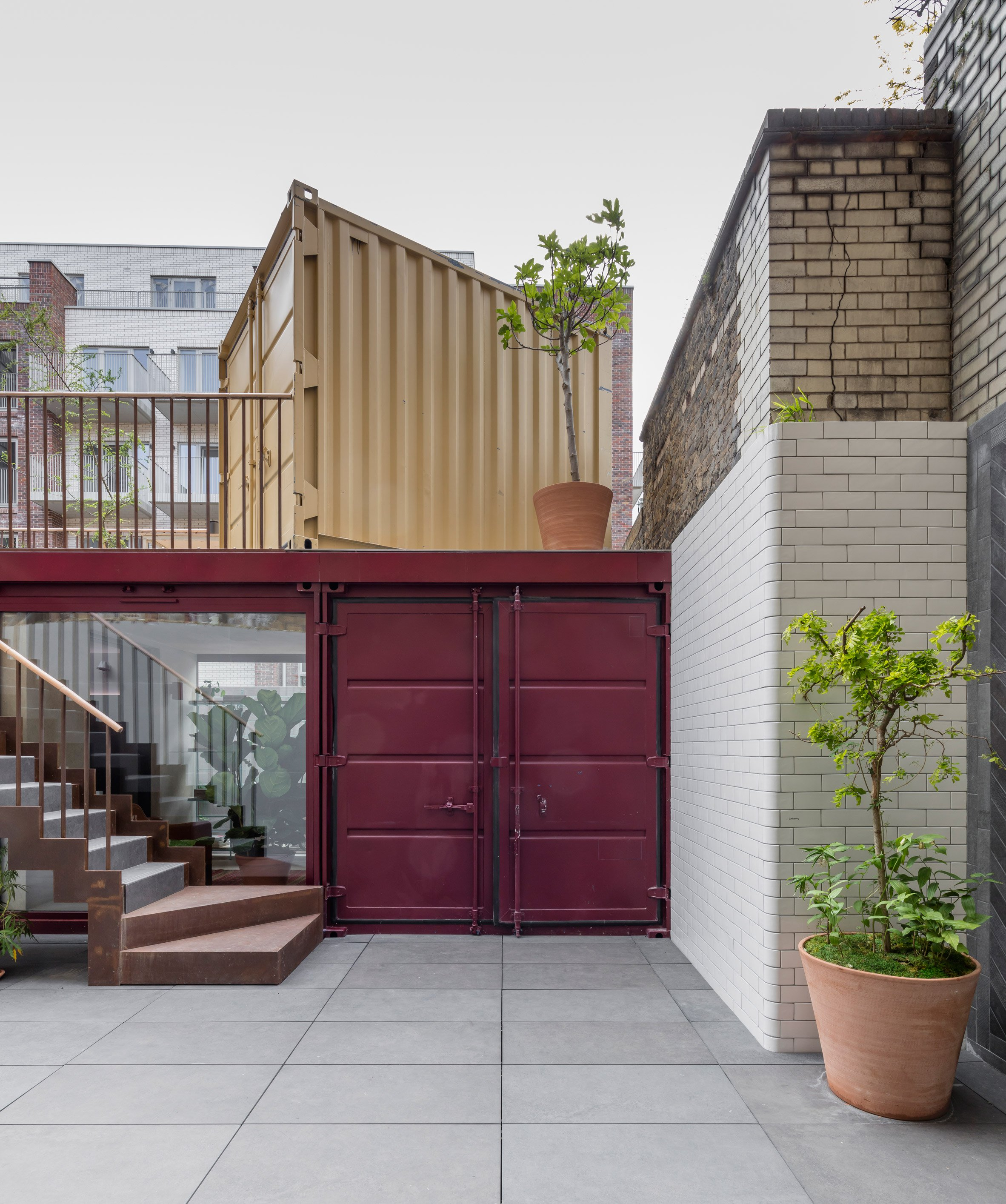 Container Haus London Simon Astridge Stacks Shipping Containers To Create Backyard