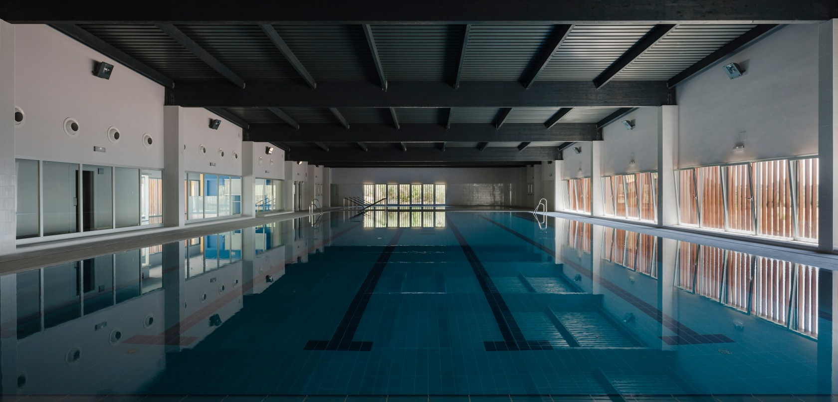 Piscinas Municipales Sevilla Municipal Indoor Pool In Constantina Seville Architizer