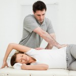 women being stretched by a physiotherapist