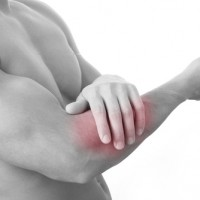 A man suffering with tennis elbow