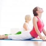 women stretching her back at post natal pilates