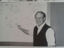 Sweater vest. Check. Glasses. Check. Pencil behind the ear. Check. Board full of Swahili. Check. Yup. We got ourselves a Math teacher here, folks.