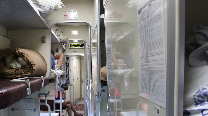 Reasons for Visiting Eastern and Central Europe. Ukrainian 2nd class kupe train carriage corridor at night. Train is going from Ukraine to Moldova.