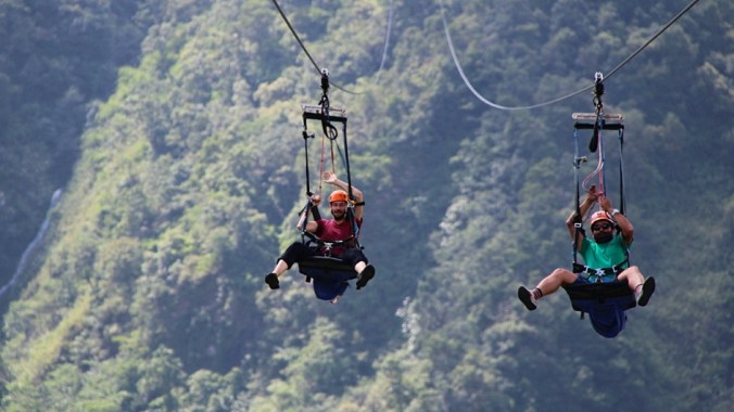 Gliding down on the HighGround Adventures ZipFlyer with Rabindra.