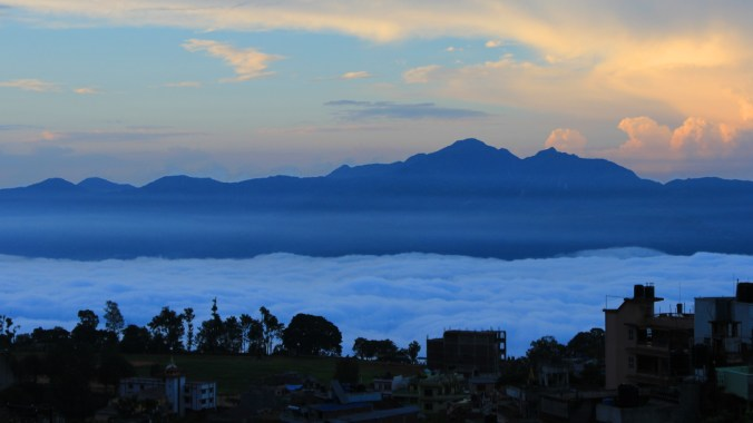 Sunrise above a cloudy valley below Tansen, Nepal.