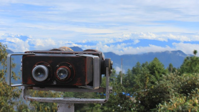 Best places to see the Himalayas in Nepal. Binoculars in the view tower of Daman, Nepal with the Himalayas in the background.