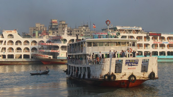 A Rocket ship leaving from Dhaka on the river by sunset.