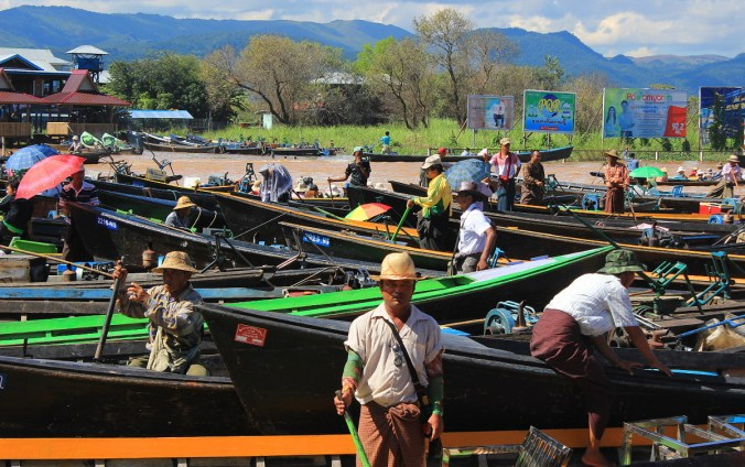 Boat tour to Inle Lake. Dozens of boatmen and longboats in a dock in Inle Lake, Myanmar.