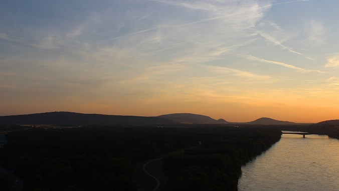 Mountains and a river on the border of Austria and Slovakia at sunset.