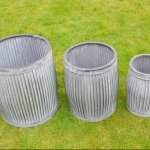 Galvanised Metal Planter Tubs Shop And Buy Now Online Metal Planter Tubs for garden camberley surrey online in store vintage from arkvintage. Classic ribbed planters in galvanised metal. Fabulous vintage look for your garden trees, plants or herbs etc. Available online now in 3 sizes