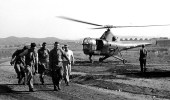 Navy corpsmen carry a wounded man from a U.S. Marine Corps HO3S-1 evacuation helicopter to a hospital in Korea on Oct. 3, 1950.