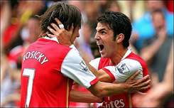 Rosicky and Fabregas celebrate Arsenal's third goal