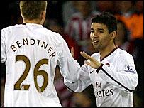 Eduardo celebrates with Bendtner against Sheffield United