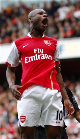 Captain Gallas celebrates his late goal