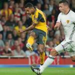 Theo Walcott's first half double eases Arsenal to Champions League win