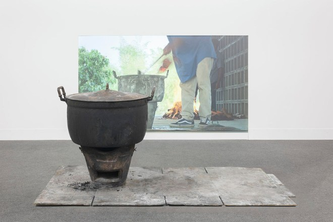 """RIRKRIT TIRAVANIJA, """"Untitled 2014 (curry for the soul of the forgotten)"""" 43 min video projection, bronze fire pot, Size Variable, 2014. Image © Tang Contemporary Art"""