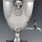 A Neoclassical 18th Century Antique English Old Sheffield Plate Silver Tea Urn with Rams Head Ornaments, c. 1790.