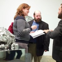Mike Weiss (on far right) with guests at the gallery
