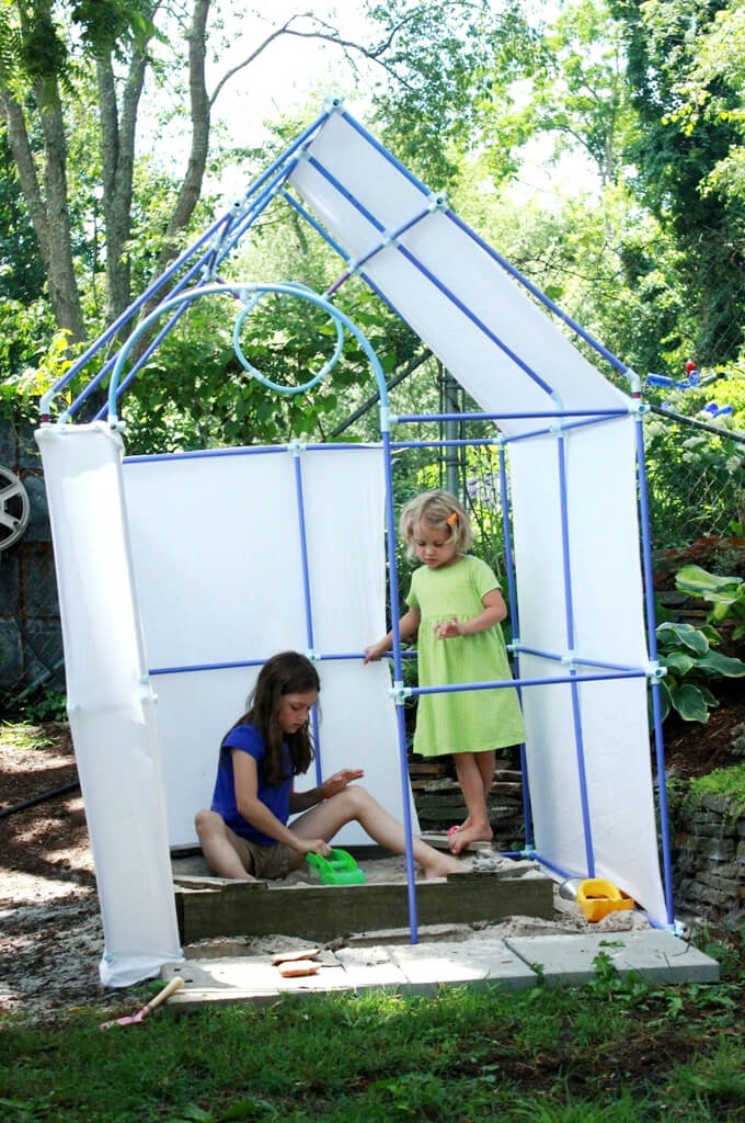 Playing in the Backyard Playhouse