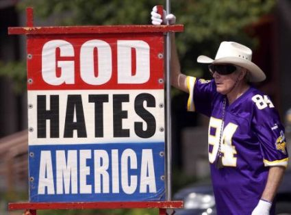 Fred Phelps Sr. of Westboro Baptist in Kansas displays one of his infamous protest signs, Photo by Capital-Journal File Photo/MBO