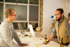 Dana Haugaard (right) explains how his work changes the viewers' perception of senses and space.