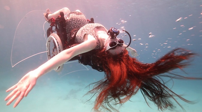 Artist: Sue Austin performing in her underwater wheelchair. Copyright: wearefreewheeling.org.uk. Video Still: Norman Lomax.