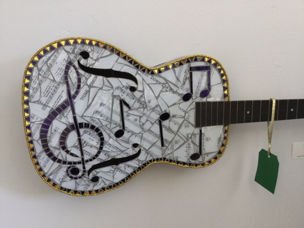 Mosaic Guitar with musical notes