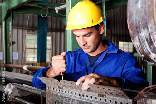 industrial mechanic repairing heavy industry machine - Buy this
