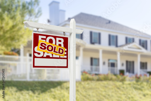 Sold Home For Sale Sign in Front of New House - Buy this stock photo