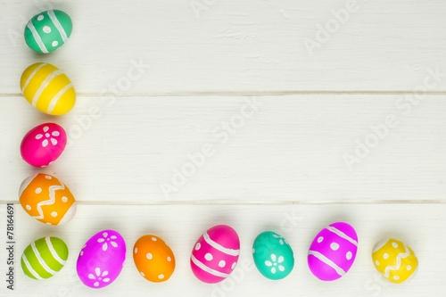 Colorful Easter egg corner border against white wood - Buy this