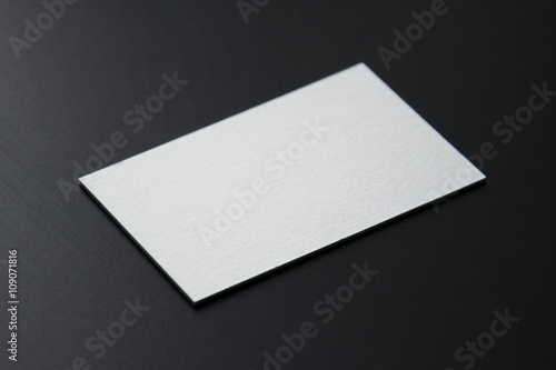 Blank white business cards on a black background Photo mock-up