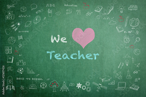 We love teacher message on green chalkboard with doodle free hand