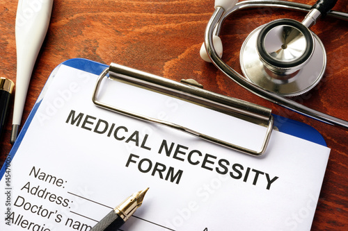 Medical Necessity form on a table - Buy this stock photo and
