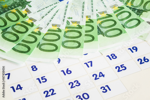 Salary day Euro banknotes on the background of the calendar