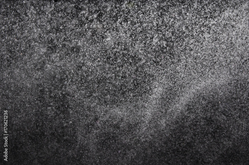 Snowstorm texture,Water dust in motion like snow on black,Watercolor
